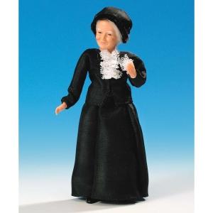 Ältere Dame im schwarzen Jackenkleid
