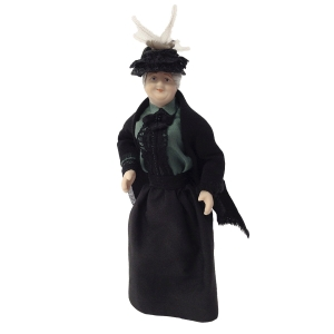 Elderly lady with cape and hat